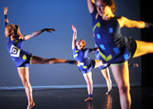 student dancers in blue