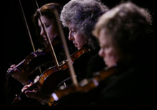 Photopgraph of three violinists from Chamber Ensemble