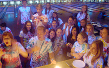 summer students in tye dye at a bowling ally