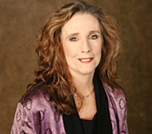 Photograph of Karen Curry in Purple Jacket