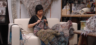 Photographs of Movana Chen knitting paper