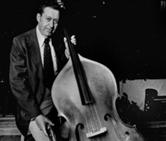 Black and White photograph of Arian holding bass on stage