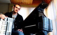 Image of Matt Campana with a piano in the background