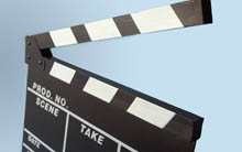 Image of a movie board on a blue background