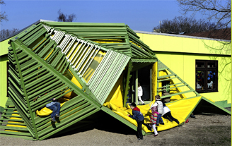 Photograph of an innovative school house and playground