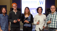 Photograph of winning students holding their microphones