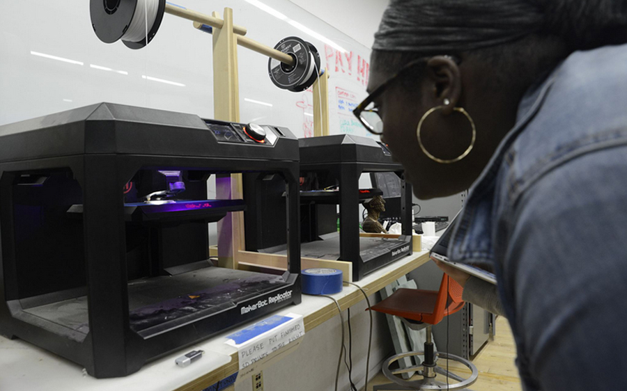 Student working on 3D printer in Hybrid Making Lab