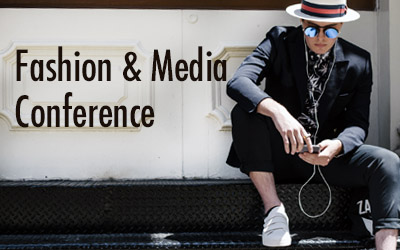 Fashion and media conference image with a man in a suit, hat, and sunglasses