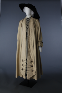 Ecru coat with tassels over striped day dress